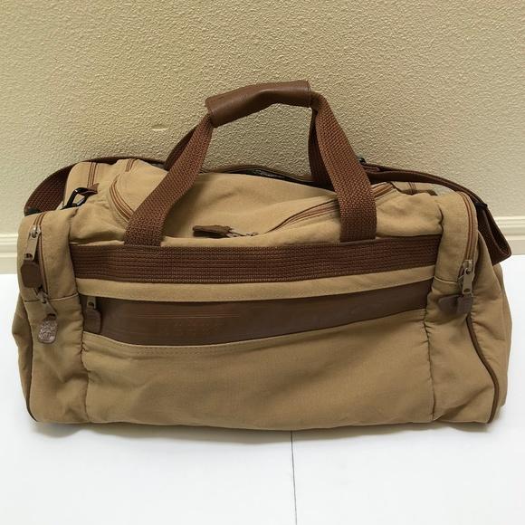 6c76b43895 Eddie Bauer Handbags - Vintage Eddie Bauer Ford Leather Canvas Duffle Bag